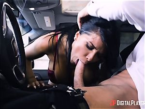 Romi Rain pulverized in the back of the car