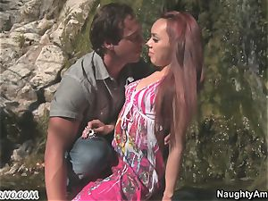 Exotic porn with a red-haired suntanned latina near a waterfall