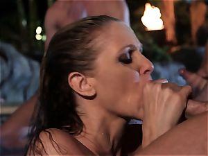 Julia Ann deep throats a group of stiffys in a pool
