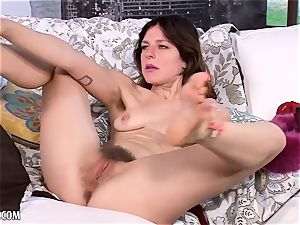 Rose Vermillion flaunts and strokes her unshaved puss