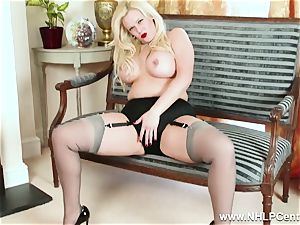 curvy platinum-blonde drains in grey nylons and high high-heeled slippers